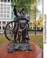 centro urbano, statua, pionieri