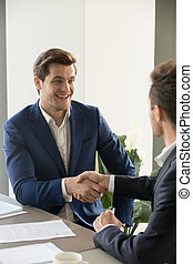 CEO congratulating new member of business team