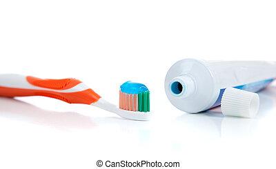 cepillo de dientes, pasta dentífrica, fondo blanco, naranja