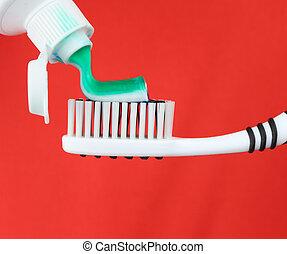 cepillo de dientes, y, pasta dentífrica
