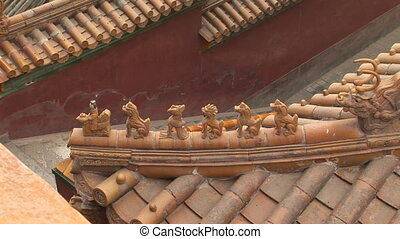 Ceramic Animals on Roof - Architectural details of glazed...