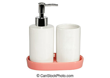 Ceramic bath set of liquid soap and glass, on a oink tray, isolated on white backgound