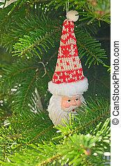 Ceramic Christmas toy Santa Claus on the Christmas tree