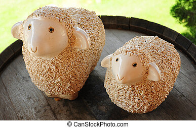 ceramic couple sheep on the wood barrel