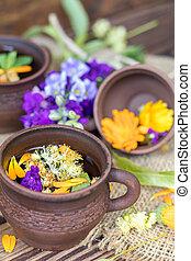 Ceramic cups of healthy herbal tea