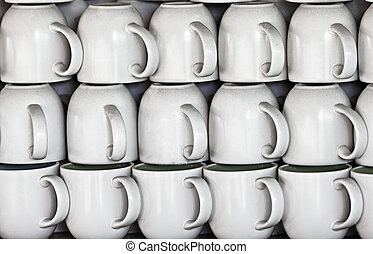 Ceramic cups on market stall - White ceramic cups on the ...