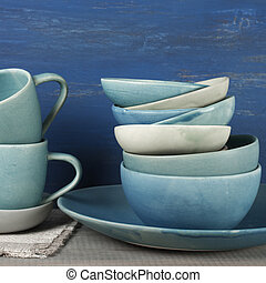 Ceramic dishware set - Handmade blue crockery set against...