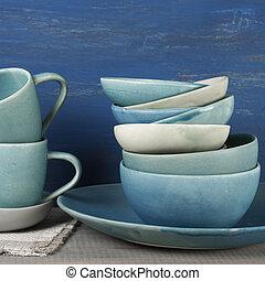Ceramic dishware set - Handmade blue crockery set against...