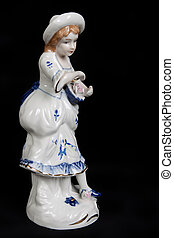 ceramic figurine of a girl with a basket