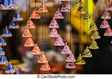Ceramic hanging bells in the handicraft mart Kaziukas, Vilnius, Lithuania