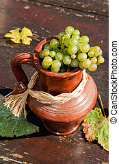 Ceramic jug with wine grape