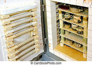 Ceramic kiln - Ceramic production kiln oven with cups and...