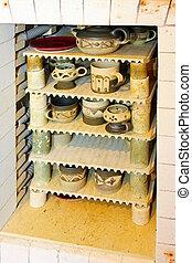 Ceramic kiln oven - Ceramic production kiln oven with cups...
