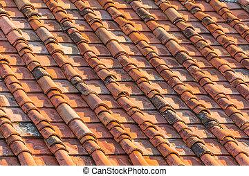 Ceramic orange clay tiles on the roof of a building.