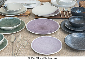 ceramic plates and cups of different colors