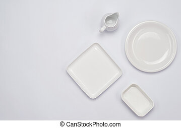 Ceramic plates on white background. Top view.