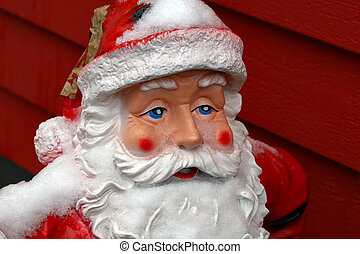 Ceramic Santa Claus at the entrance to the House