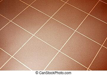 Ceramic tile floor brown color. Shallow DOF
