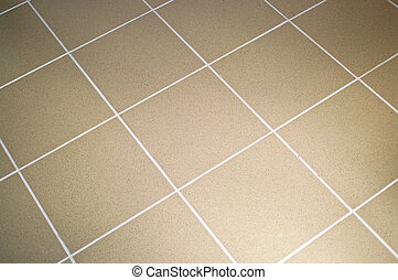 Ceramic tile floor brown color. Shallow DOF