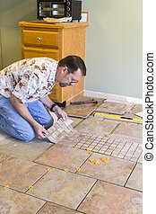 Ceramic Tile Installer - Man installing ceramic tile in ...