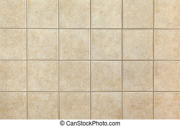 Beige ceramic tiles on the wall. Design background.