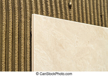 Ceramic tiles on a wall installation. Home improvement and renovation.