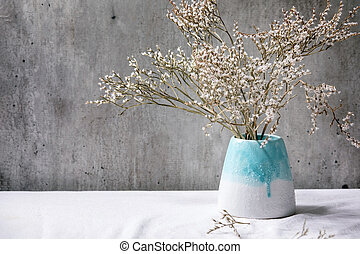 Ceramic vase with dry flowers