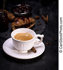 ceramic white cup with black coffee