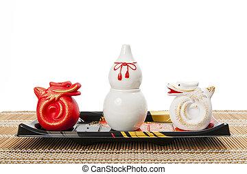 Ceramic white gourd in plastic tray
