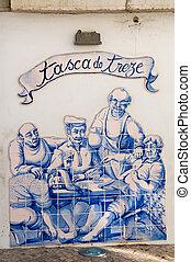 Ceramics in a wall of restaurant, Sesimbra, Portugal