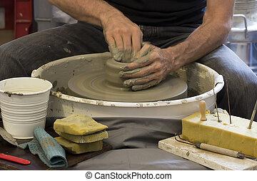 Ceramist at work in the workshop - ceramist working at the...