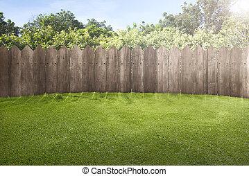 cerca de madera, en, verde, jardín