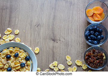 Cereal and fruit for Breakfast on the table.