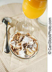 Cereal bowl with orange juice
