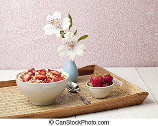 cereal bowl with strawberres in a tray