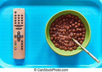 Cereal breakfast and TV remote