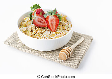 Cereal Conrflakes with strawberry on jute with white background