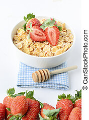 Cereal Conrflakes with strawberry on white background