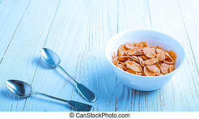 Cereal for Breakfast is on the table. Delicious rings from milk.