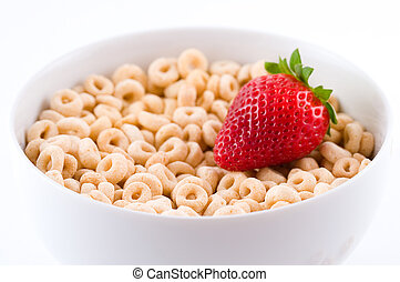 Light breakfast. A bowl with cereal (whole grain oats) and fresh strawberry. Selective focus.