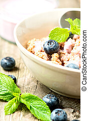 Cereal with yogurt and fresh blueberries close up - Cereal...