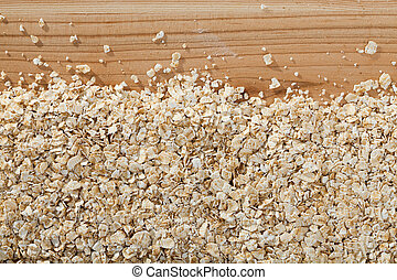 Cereals and healthy eating concept - oatmeal flakes. Natural background