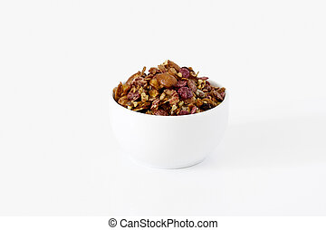 Cereals in a cup on white background
