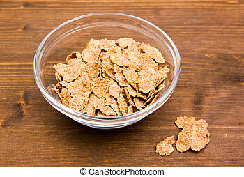 Cereals in glass bowl on wooden table