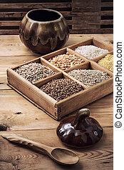 cereals in wooden box in rustic