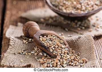 Cereals (wheat, rye, barley, oat and millet) on dark wooden...