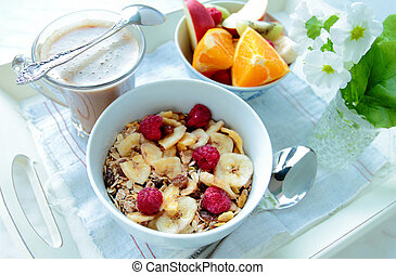 Cereals with berries and fresh sliced fruits for breakfast