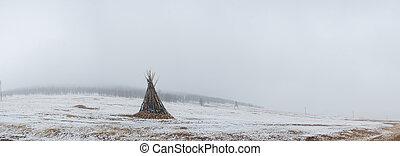 ceremonial bonfire in snowy mongolian prairie