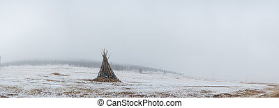 ceremonial bonfire in snowy mongolian prairie