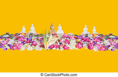 Ceremonial flowers and buddha figurines